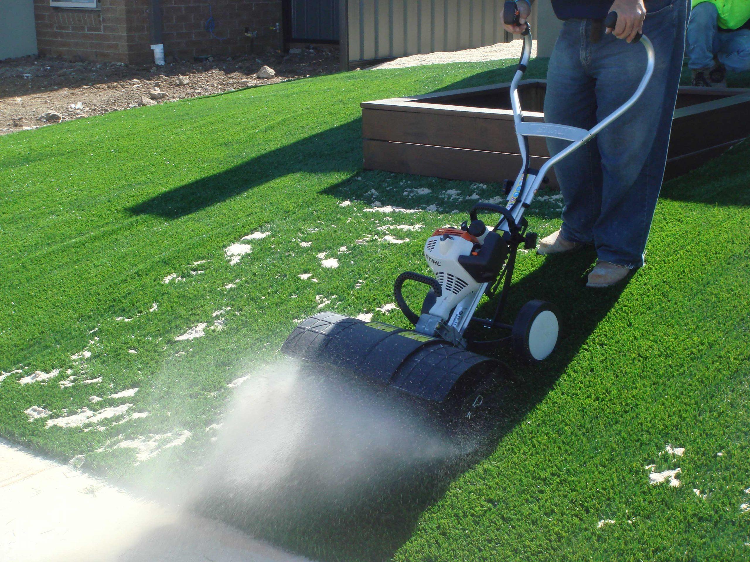 CCGrass, artificial grass installation, brush sand